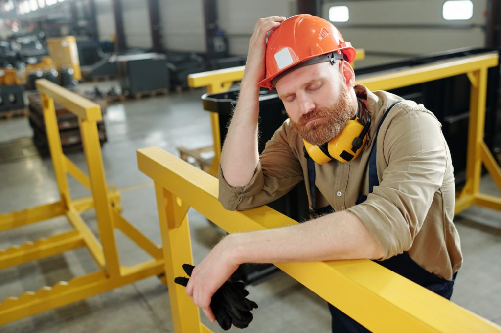 Puzzled factory worker